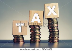 stock-photo-tax-concept-with-wooden-block-on-stacked-coins-313474802 (1)